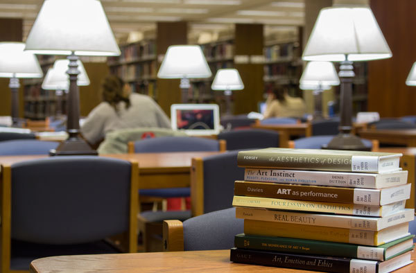 Books Stacked on a Study Table in the Library